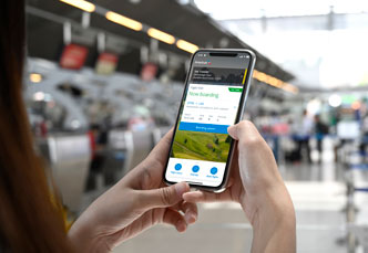 Gate agent scanning a customer's mobile app